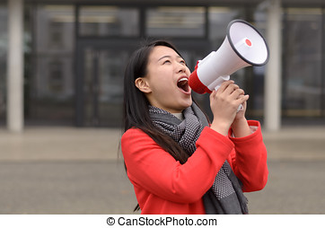 Modern young Chinese woman protesting - Modern young urban...