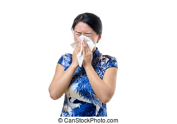 Unwell young Chinese woman blowing her nose - Unwell young...