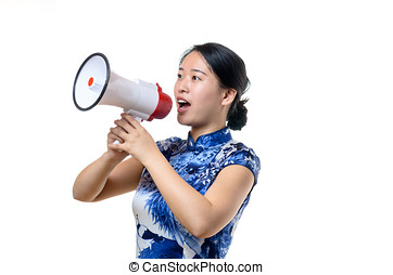 Attractive Chinese woman in traditional dress shouting into...