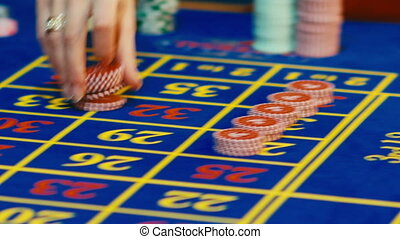 Betting chips - Casino Roulette People playing Roulette in a Casino