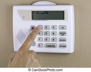home security - a person programing a home security system