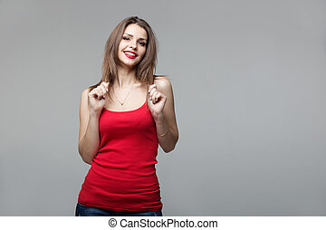 Portrait of beautiful brunette woman posing in studio