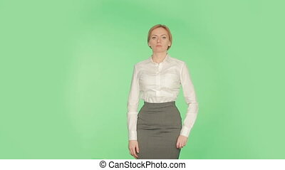 Body language. Beautiful blonde girl in a white blouse on a...