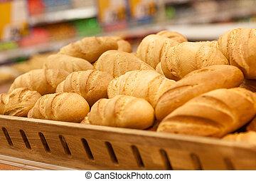 Fresh wheat bread on shelf in supermarket