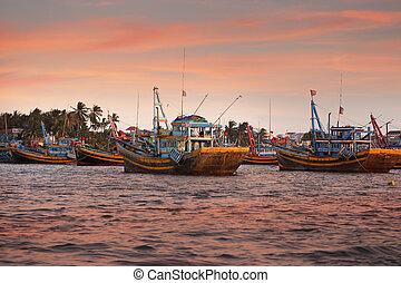 Fishing ships at sunset in Mui Ne, Vietnam