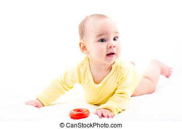 Sweet Baby Crawling And Playing With Toys, Isolated On White Background