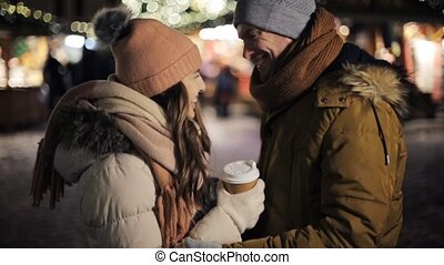 happy couple with coffee at christmas market - winter...