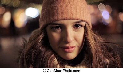 happy young woman in winter hat at christmas - winter...