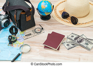 Travel preparation : compass, money, passport, road map...