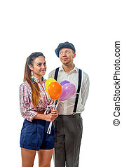 young man in a cap gave the girl balloons - image of a young...