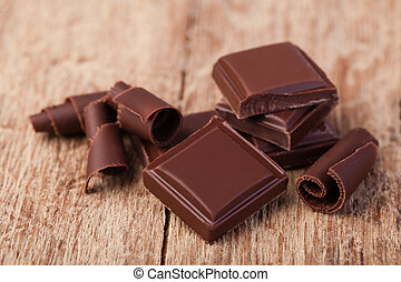 dark chocolate - Pieces of natural dark chocolate on wooden...