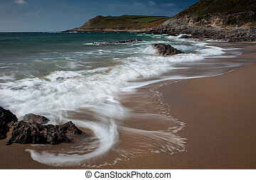 Swirling waves at Fall Bay Gower Swansea - The rugged coast...