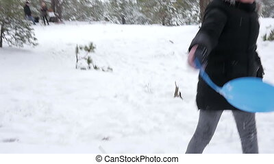 Close shot of little girl running on the hill in winter park