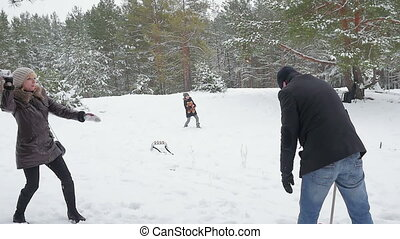 Family playing by throwing snowballs in the winter 96fps
