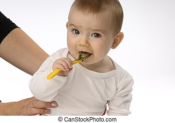 feeding baby - supervosory mother on feeding baby