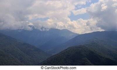 Clouds in the mountains. Zoom. Time Lapse. Sochi, Russia....