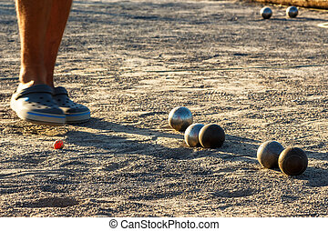 Petanque game. - Game of petanque on the ground. Horizontal...