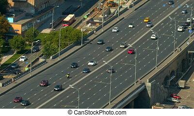 a wide road bridge, go over the bridge cars, top view.
