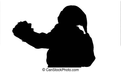Silhouette Santa Claus holding a big present  doing a selfie on smartphone