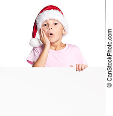 Boy in Santa hat with blank - Amazed or surprised little boy...