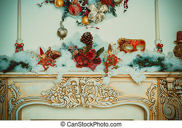 Christmas decorative garland with fir branches, red and silver baubles, pine cones and other ornaments, in the new year background