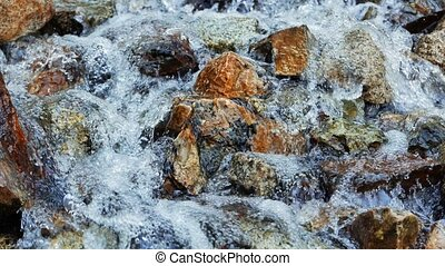 Clear water runs over the stones. Valley Issyk-Ata,...