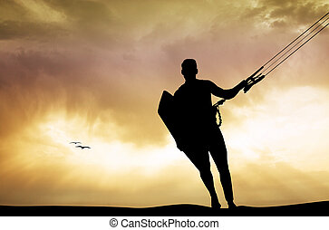 kite surfer at sunset - illustration of kite surfer at...