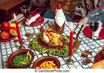 Roasted chicken, table setting. Thanksgiving table served...