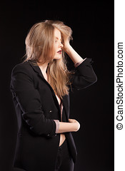 Gorgeous sexy woman in fashion suit on black background
