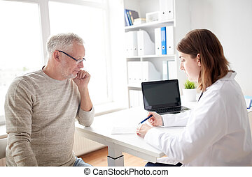 old man and doctor with prescription at hospital