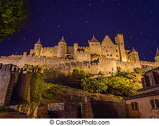 Medieval city of Carcassonne, France, fully lit at night