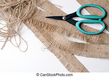 brown scissors and grain sacking linen