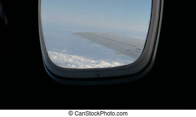 Flying on jet plane - Traveling by air. View through an...