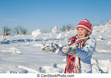 Happy little girl playing on winter snow day. - Cute little...