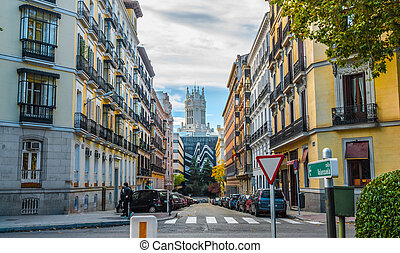 People cross the Street, in the City of Madrid, Spain. -...