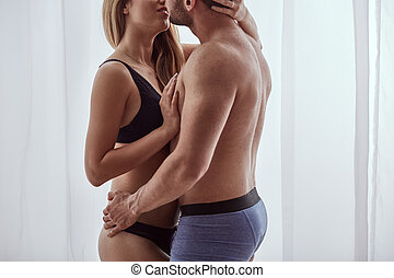 Romantic couple enjoying foreplay, embracing each other