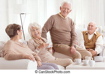Senior friends drinking tea - Happy senior friends drinking...