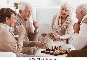 Pensioners playing chess - Happy pensioners of rest home...