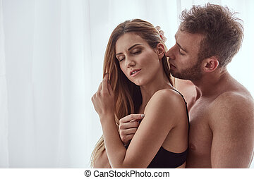 Man kissing woman's neck - Handsome man kissing woman's neck...