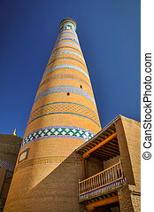 High tower in Khiva - Large tower made of bricks with blue...