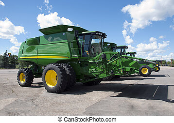 Combines - New modern green colored big harvesting machines