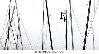 Masts and a street lamp - Yacht masts and a solitary street...