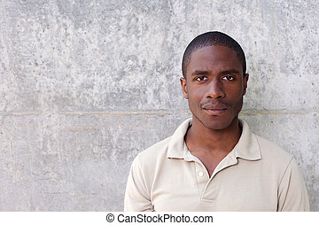 young black man staring - Close up portrait of young black...
