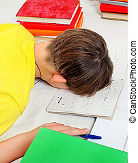 Tired Kid doing Homework at the Home