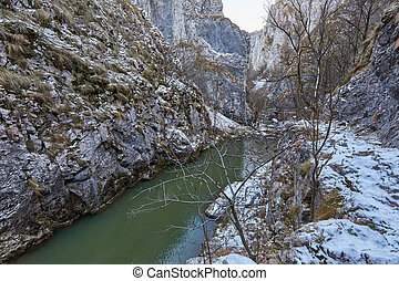 River in mountain pass - Winter landscape with a river in a...