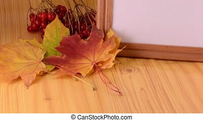 Yellow maple, viburnum and empty wooden box plate