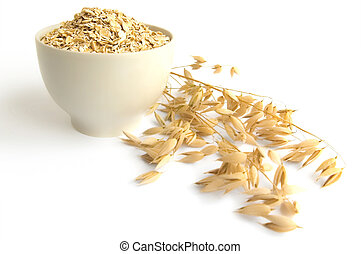 Rolled oats in a teacup - Oat flakes in a tea cup, ripe...