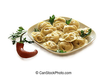 Ravioli with pepper and fresh herbs. - Dumplings with hot...
