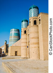 Blue tops in Khiva - Photo of large building made of bricks...
