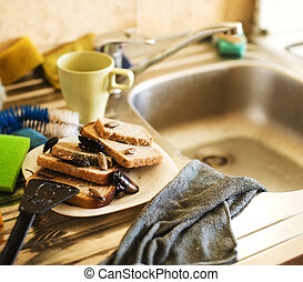 dirty kitchen pile of filthy dishes infested with roaches,...